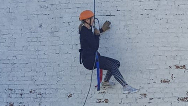 Susan Abseiling down Leasowe Lighthouse to raise money for Natural Breaks